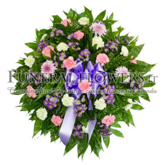 Corona funebre di fiori sui toni del viola giallo e rosa