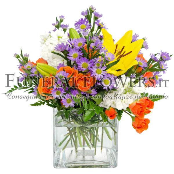 Mazzo funebre di vari colori con rose arancio