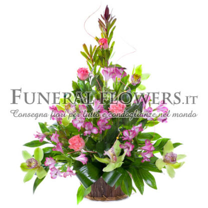 Composizione floreale funebre sui toni del rosa
