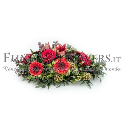 Cuscino funebre di fiori rossi