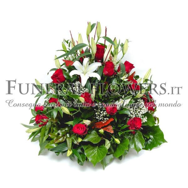 Cuscino funebre di rose rosse e lilium bianchi