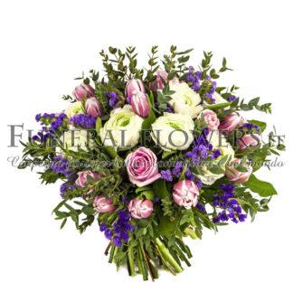 Bouquet floreale funebre di fiori rosa e viola