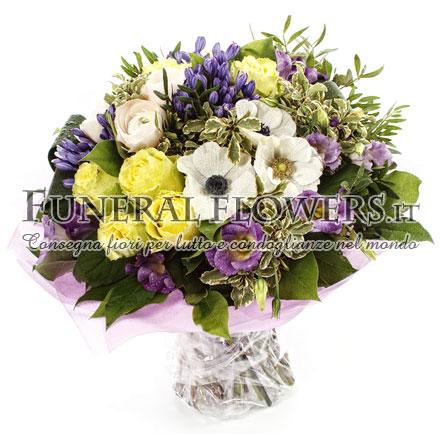 Mazzo funebre con rose gialle e fiori bianchi e viola